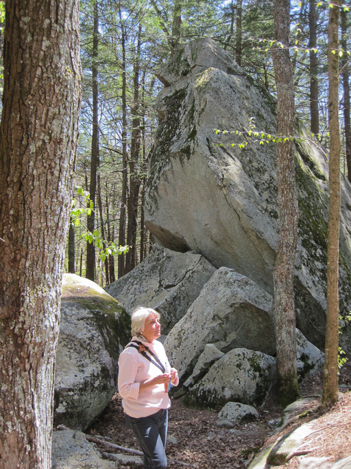 Photo of Hawk Rock with Beth Herr standing in front of it